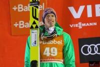 Severin Freund na podium (fot. Julia Piątkowska)