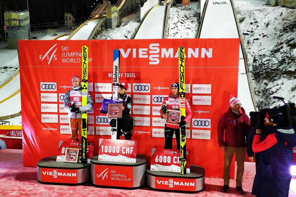 Podium konkursu (od lewej: Geiger, Sato, Aschenwald), fot. Anastasia Poryadina